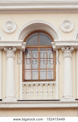 two columns between the window in an old building.