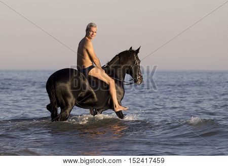 horseman and his horse in the sea