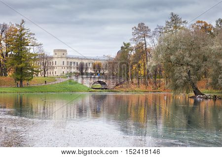 GATCHINA ST. PETERSBURG RUSSIA - OCTOBER 16 2016: The Great Gatchina Palace and reflected in the Pond. The Gatchina Palace was one of the favourite residences of the Imperial family