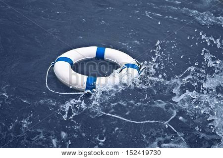 Lifebuoy lifebelt lifesaver in ocean storm as help hope sos medicine concept