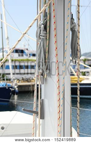 Yacht mast with lots of ropes and katantov