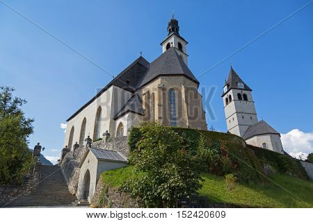 KITZBUEHEL, AUSTRIA - SEPTEMBER 2016 : Low angle view of Pfarrkirche St. Andreas and Church of Our Lady (Liebfrauenkirche), cemetery on hill in Kitzbuhel, Austria on September 27, 2016