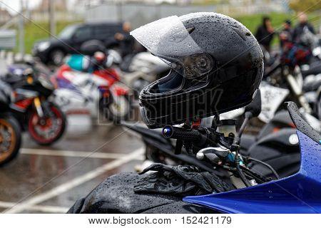 Moto Helmet On Motorcycle Handlebars