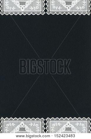Image of lace borders on black background
