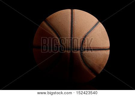 basketball on a black background sport concept