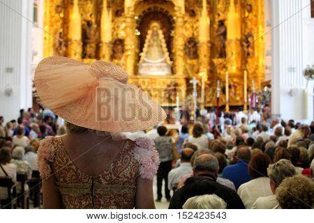 HUELVA/SPAIN - 9 OCTOBER 2016: Piligrims assisting at the sunday holy mass at the shrine of El Rocio
