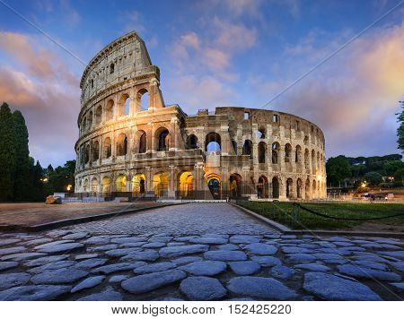 View of Colosseum in Rome and morning sun Italy Europe.