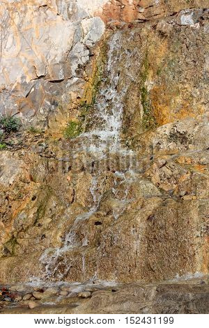 a small mountain brook running over stones closeup