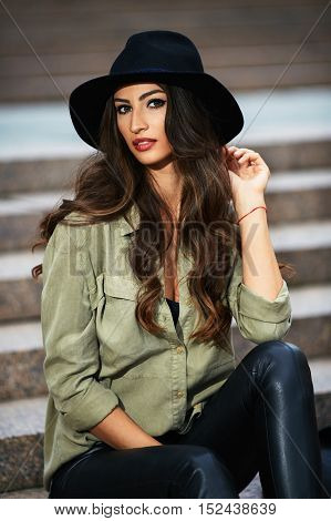 Portrait Of Attractive Elegant Young Woman With Black Hat Sitting On The Stair And Enjoying The Even