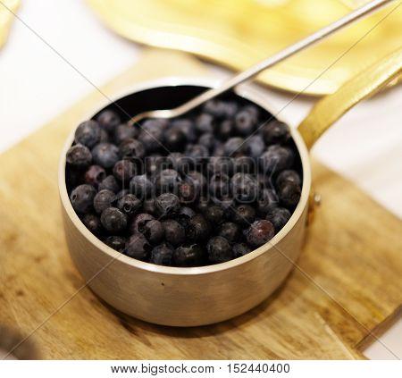 Bowl of bilberries or blueberries, Healthy food Bilberries in a bowl, blueberries in a bowl. Fresh blueberries close up. Bilberries close up