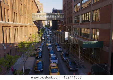 NEW YORK CITY, USA - MAY 7, 2014: The traffic jam on the streets in NYC on sunset on May 7, 2014. The view from the High Line in Chelsea, NYC. The cross between West 15th street and 10th Avenue.