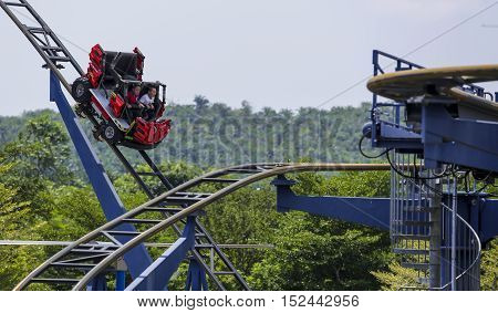 Two Kids Riding Roller Coaster At Legoland Malaysia