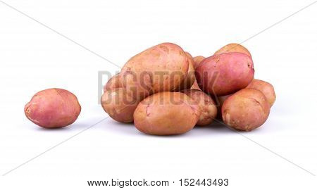 Pile of fresh potatoes isolated on white background.