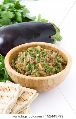 Eggplant baba ganoush and ingredients isolated on white background