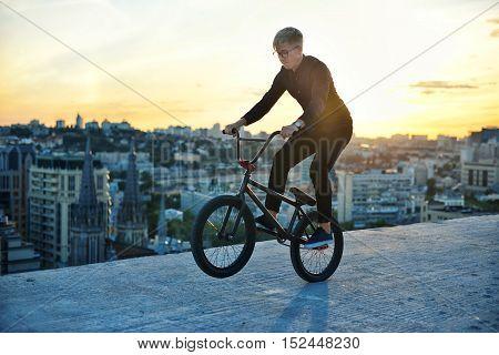 Bmx Rider Making A Bike Jump Called Table Top
