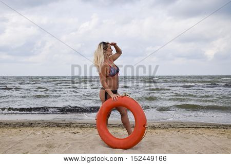 Beautiful Blonde With A Lifebuoy