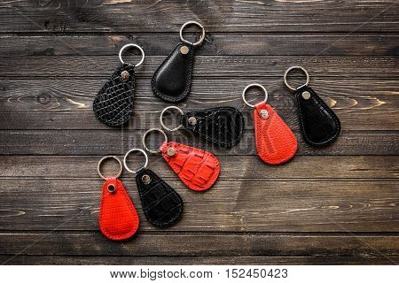 Keys attached to leather keychain , on darken wooden background