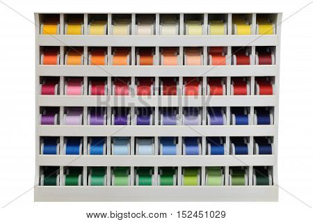 stand with multicolored threads isolated on white background