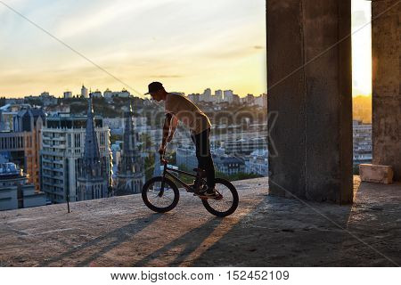 Bmx Freestyle. A Man On Bmx Doing Tricks.