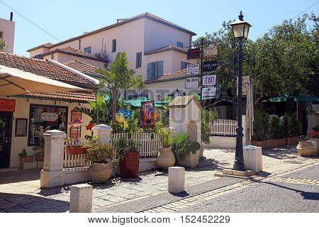 ZIKHRON YAAKOV, ISRAEL - AUGUST 20, 2016: Houses on main street in Zichron Yaakov, Israel. It was one of first Jewish settlements in Israel founded in 1882 by Baron Edmond James de Rothschild. The town draws many tourists to its picturesque setting