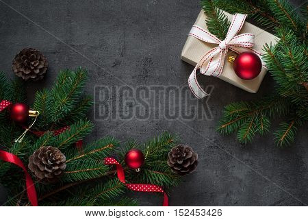 Christmas gift tree branch and decorations on dark slate background. Christmas present background.