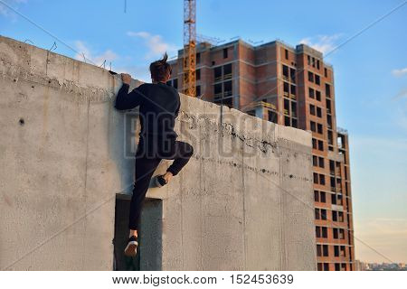 Man Doing Parkour In The City On The Roof