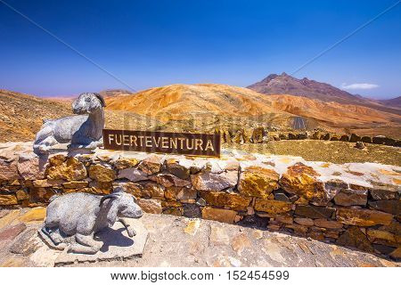 FUERTEVENTURA, SPAIN - JULY 1 2016: Sculptures on the top of vulcanic Fuerteventura mountains Spain.