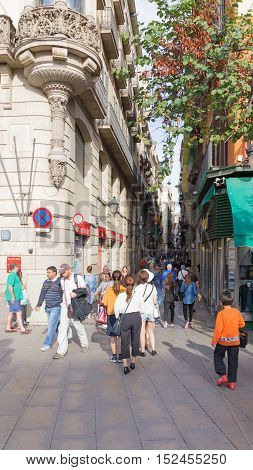 Barcelona - 10 October 2015: Many people and tourists are on Boqueria street in the pedestrian area of 10 October 2015 Barcelona Spain