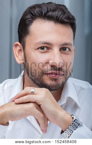 Middle eastern young attractive businessman with beard studio portrait