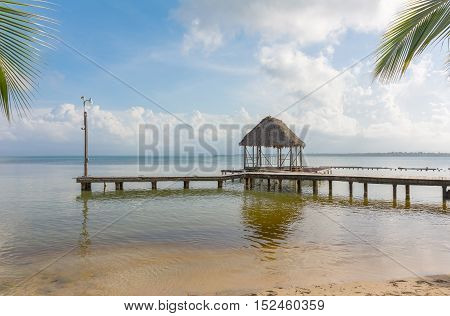 Pier on Boca del Drago beach in the evening, archipelago Bocas del Toro, Panama