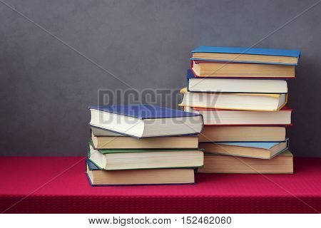 Pile of books on a table. Library reading literature. Education back to school.