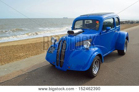 FELIXSTOWE, SUFFOLK, ENGLAND - AUGUST 27, 2016: Classic Blue Hot rod  on seafront promenade.