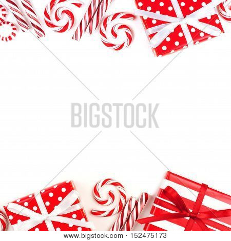 Christmas Double Border Of Red And White Gifts And Peppermint Candies Over A White Background