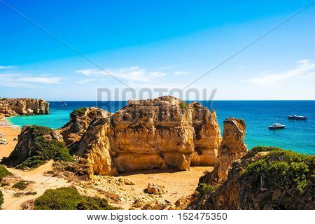 beautiful beach Pria do Castelo with cliff and rock formation in Albufeira Algarve region Portugal