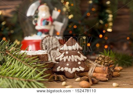 Christmas Gingerbread Cookies Against Background Branch Of Fir Tree