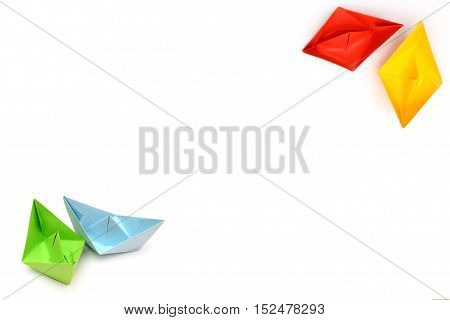 background with origami paper boats, four ships, boats in the corner, red yellow blue green boat origami boats in focus