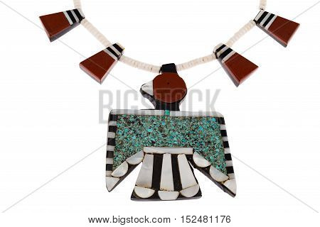 Close up of Native American Jewelry, Santo Domingo Turquoise and Coral Thunderbird and Tag Necklace isolated on white.