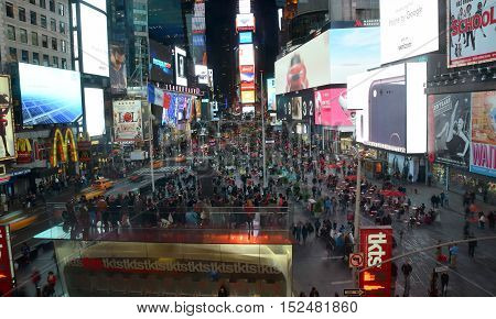 New York USA - October 11 2016: Tourists and locals mix on New York City's Times Square at night on. It is a major tourist destination.