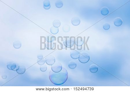 Rainbow Soap Bubbles on Blue Sky Background