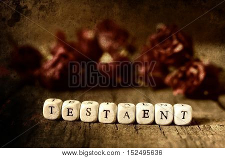 small wooden blocks with letters on the old worn wooden table