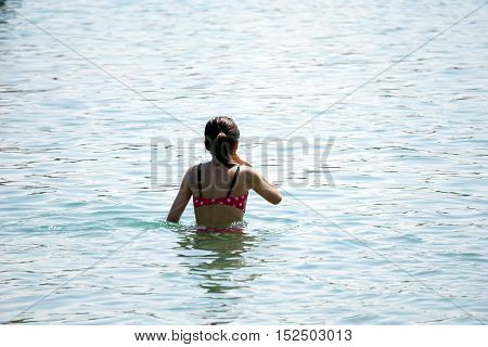 A girl swims in the water at the Zorn Park Public Beach in Harbor Springs, Michigan during August.