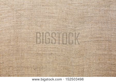 Background of natural linen fabric. Sack texture
