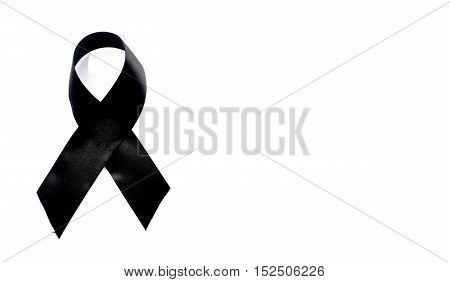 Black awareness ribbon.Mourning and melanoma symbol. Isolated on white