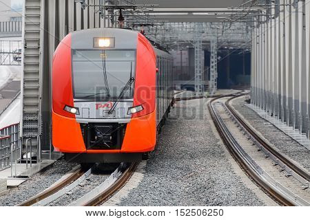 MOSCOW, RUSSIA - SEPTEMBER 11, 2016: Moscow Central Circle Line Moscow Ring Railway . Modern high-speed train moves on a rail way. Opened to passengers on 10 September 2016