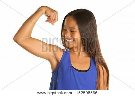 Cute Filipino Girl on a White background  wearing a tank top .  She is making a muscle and looking at her arm with a smile