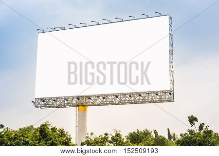 Blank billboard or poster for outdoor advertising. Blank billboard on highway. Big blank billboard for advertisement.