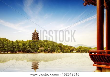 hangzhou scenery pagoda on the west lake lakefront in dusk