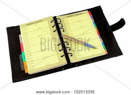 Open personal organiser with fountain pen isolated on white