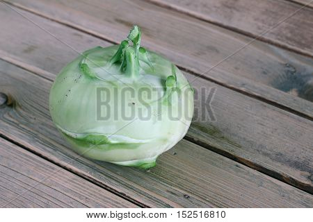 Detail of the turnip cabbage on wooden table