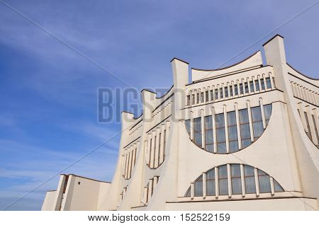 Grodno, Belarus - September 30, 2016: Looking up at the Drama Theater building in Grodno a monument of Soviet architecture with large semicircular windows and pillars.